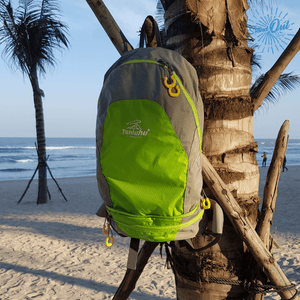 Green Packable backpack Tanluhu Duo Daypack at the hanging in tree - Stand Out Bags