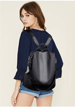 Girl wearing black anti theft backpack purse - Stand Out Bags