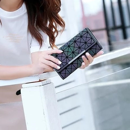 Girl holding a Trifold Luminous Wallet - from Geometric Luminous Bags