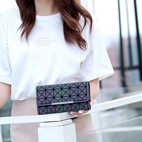 Female holding a Trifold Luminous Wallet - from Geometric Luminous Bags