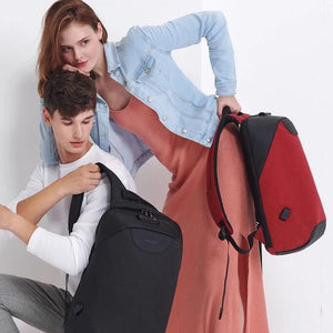 Man and woman wearing a lockable anti theft backpacks