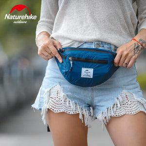 Girl wearing Blue Fanny Pack - Naturehike Packable Foldable Bag