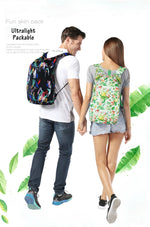 Men and woman wearing packable backpack