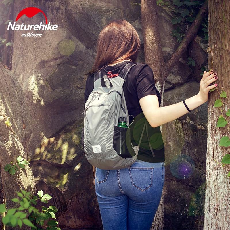 Female in the nature with NatureHike Packable Backpack