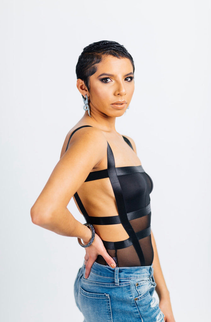 Caged vixen body suit