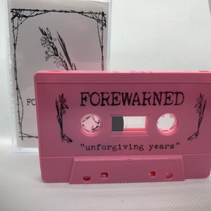 "Forewarned ""unforgiving years"" pink cassette"
