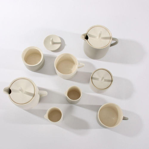 Ceramics by Sue Are for Olea Living. Mugs, milk jug, sugar pot, teapot in grey and white.