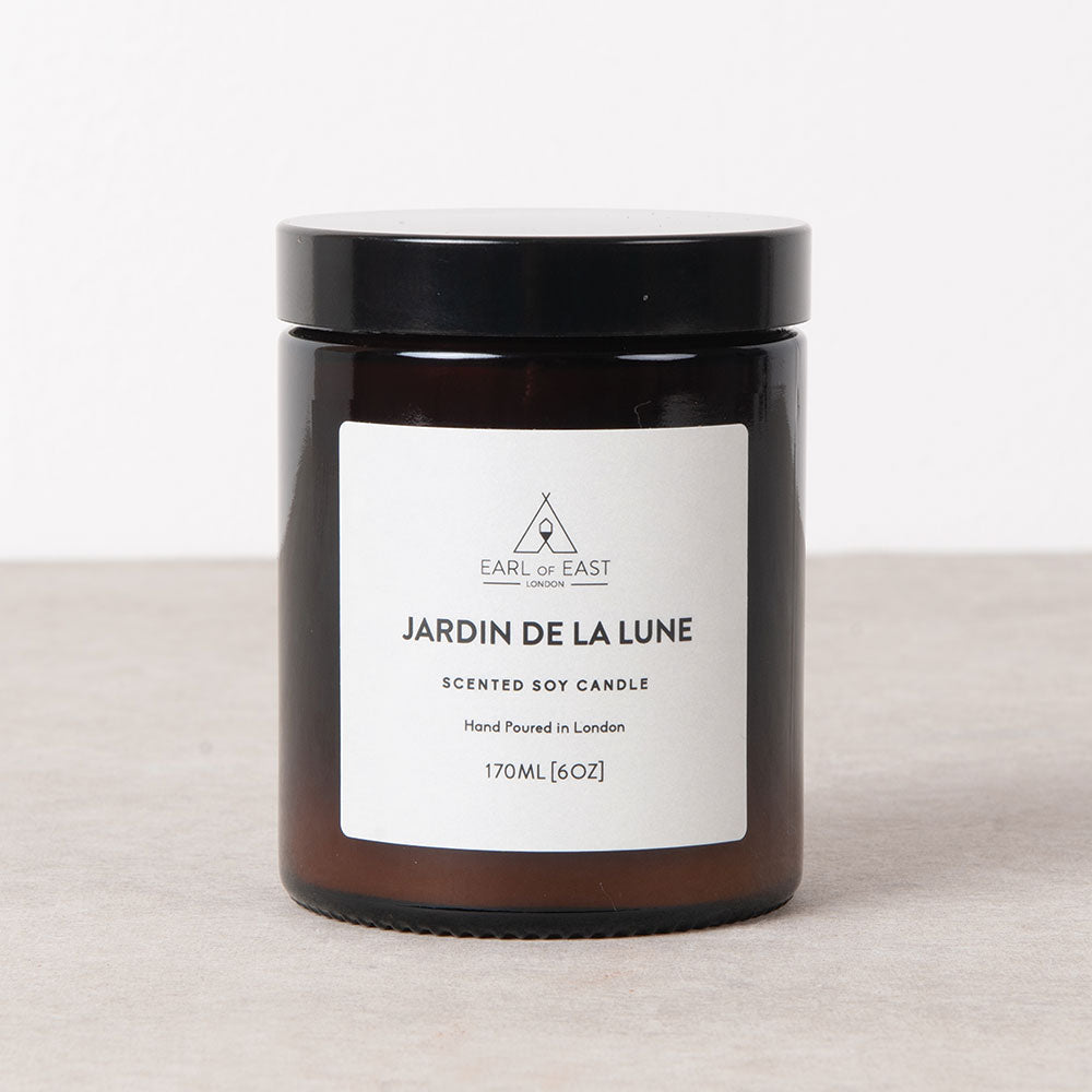 Jardin De Lan lune hand poured, bespoke blend of essential oil, soy wax candle from Earl of East for Olea Living. Deep amber apothecary jar with lid. Non GMO eco wax, self trimming wick. Burn for 40 hours, 170ml.