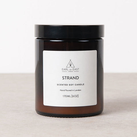 Strand scent, Earl of East, essential oil, soy wax candle for Olea Living. Hand poured, GMP eco wax, self trimming cotton wick, deep amber apothecary jar with lid. 170ml, 40 hour burn.