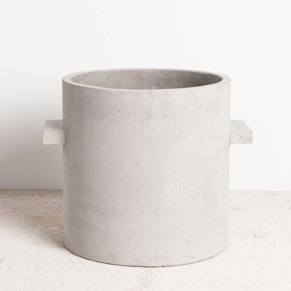 Grey concrete planter with two straight edged handles. From Serax for Olea Living.