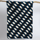 Handwoven sheep wool rug, modern geometric design in blue, black and white. Scandinavian design.  Que Onda Vos for Olea Living