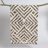 Handwoven white and grey sheep wool rug in chevron design. Scandinavian design.  Que Onda Vos for Olea Living