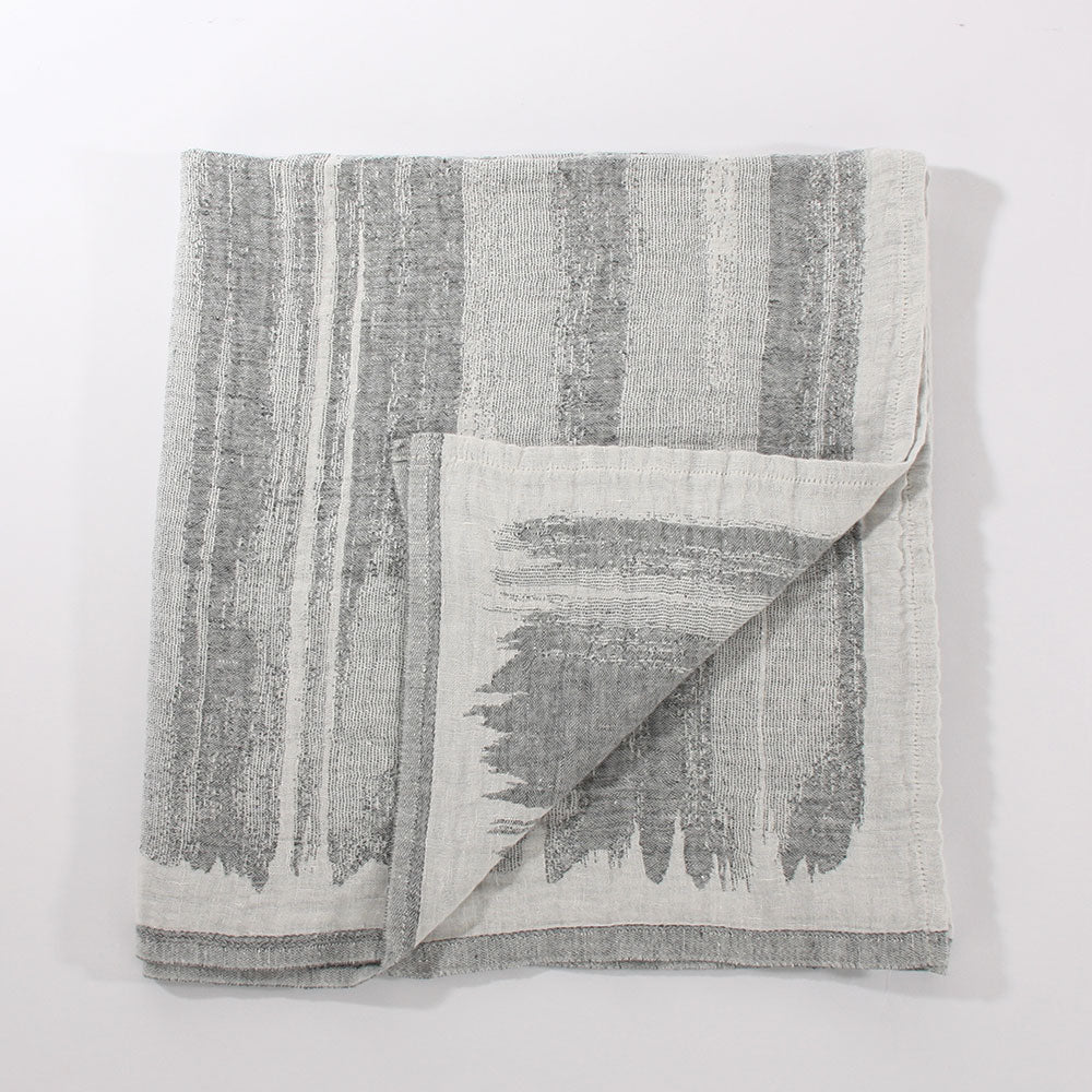 Joki 100% linen towel, multifunctional uses. Wrap, throw, blanket. Grey and White pattern.  Lapuan Kankurit for Olea Living