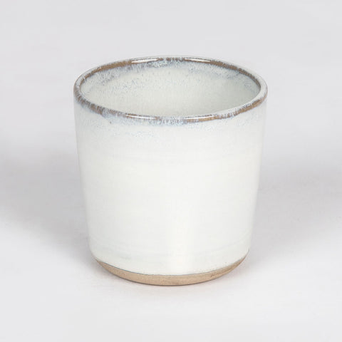 Glazed handless, off white cup from Merci range Serax for Olea Living.