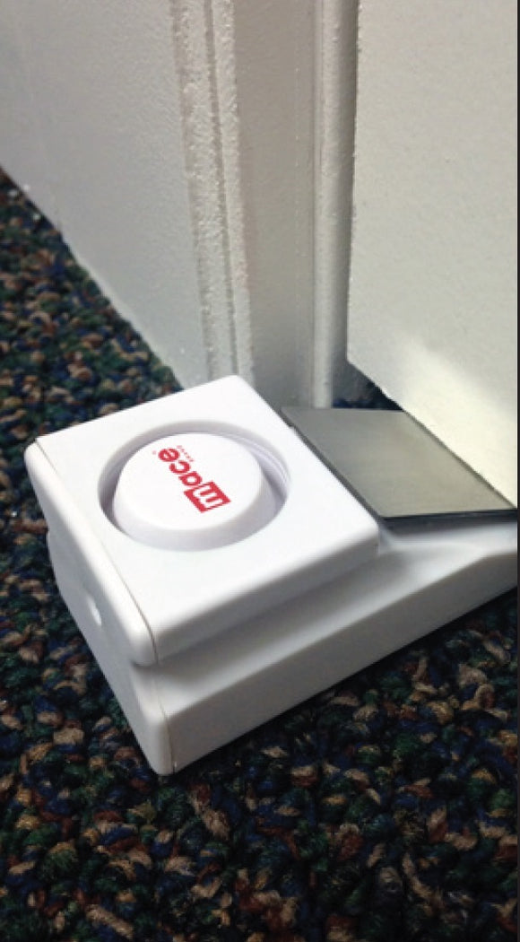 Floor picture of door alarm under a door and activated.