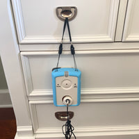 giver alarm includes a detachable strap for a variety of ways to position the alarm near the bed