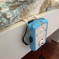 the giver alarm is shown attached to a bed using the included bed rail clip