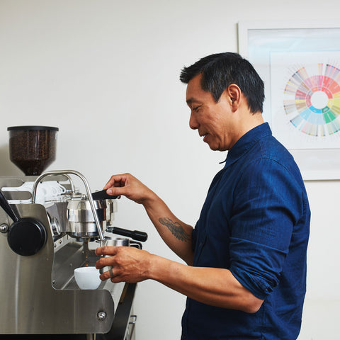a person making espresso on a synesso espresso machine