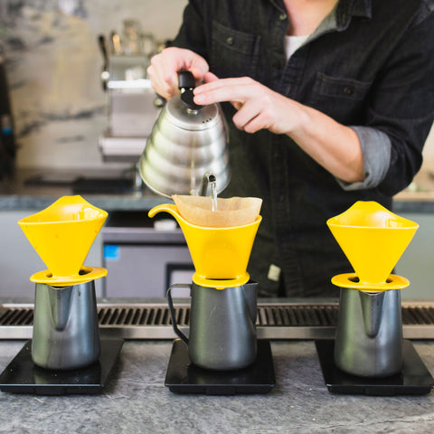a person making pour over coffee