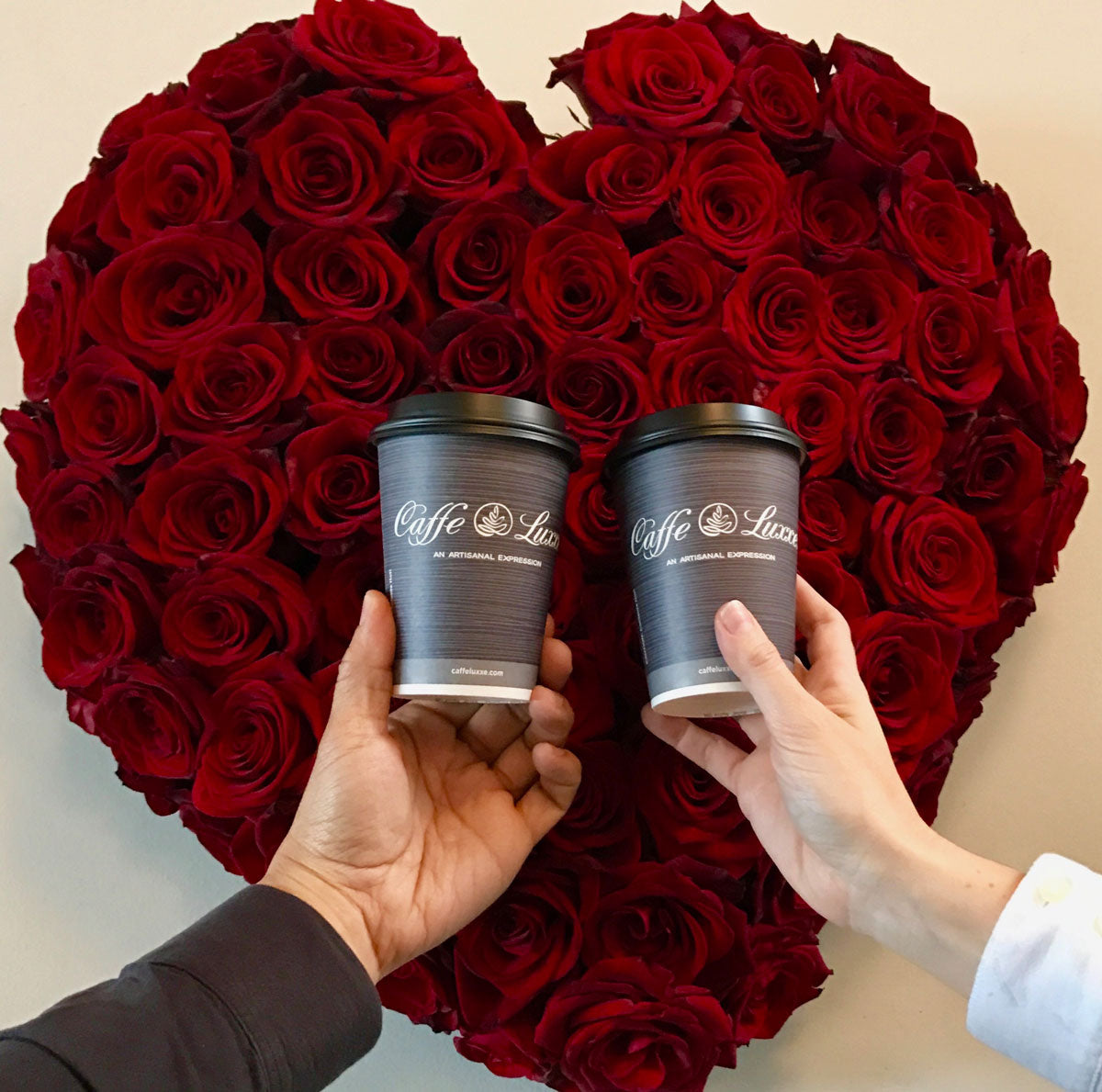 caffe luxxe coffee cups in front of heart rose bouquet