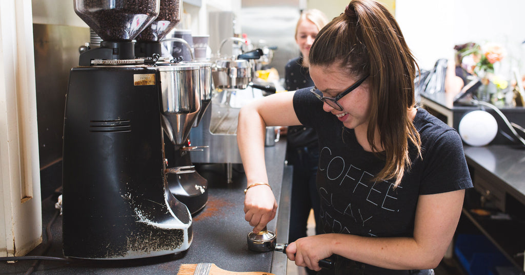 woman tamping coffee