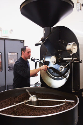 man roasting coffee