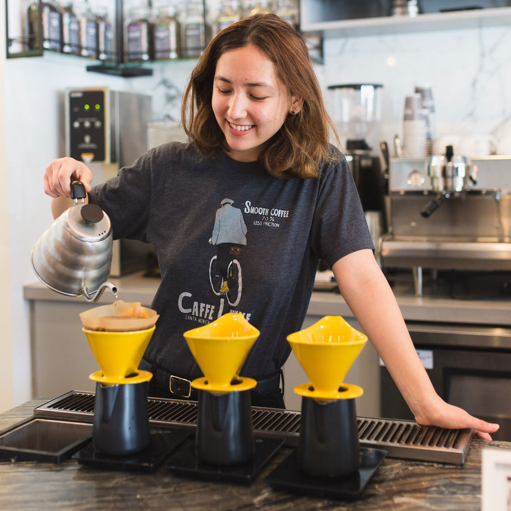 woman making pour over coffee