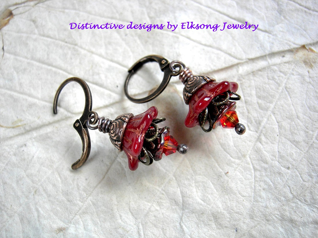 Fire flower earrings with red glass flowers, fire opal swarovski crystals & antiqued copper caps.