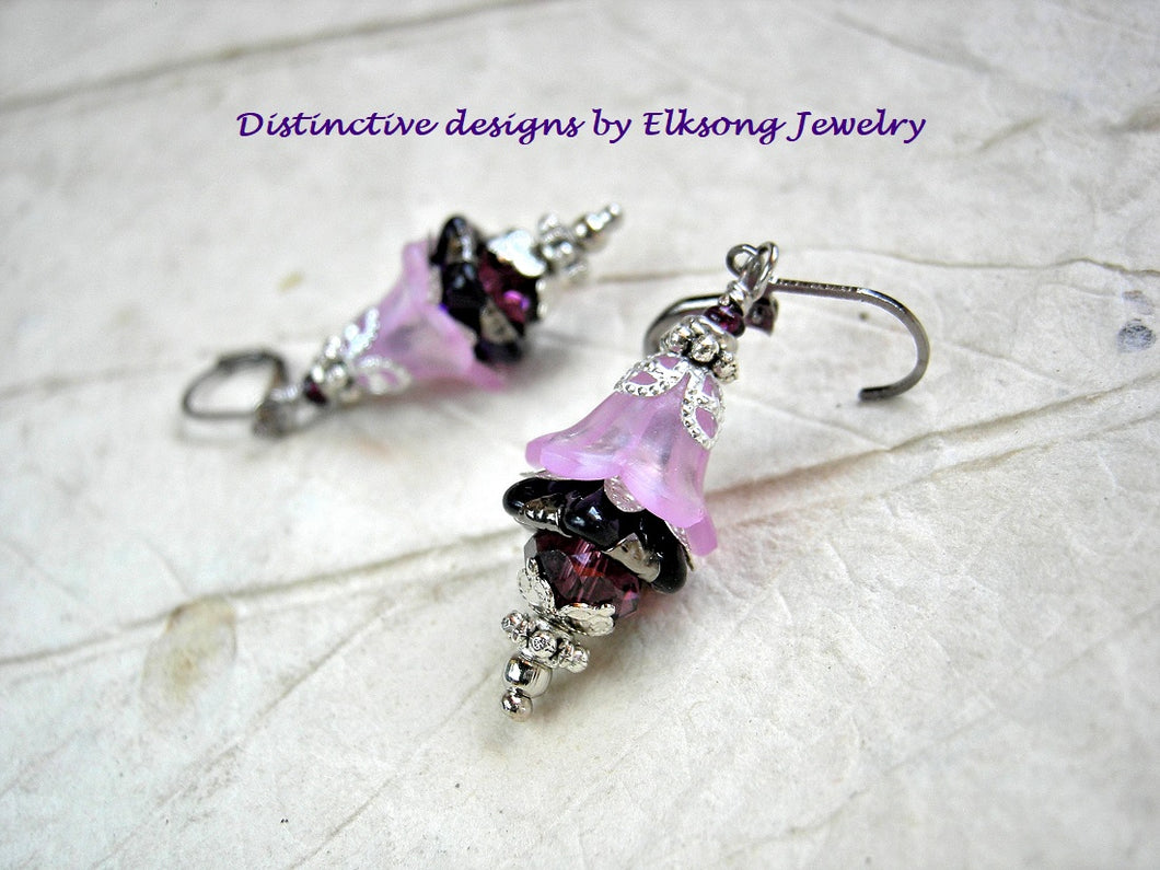 Flower nymph earrings in delicate purple resin flowers, dark amethyst glass flowers & silvery details.