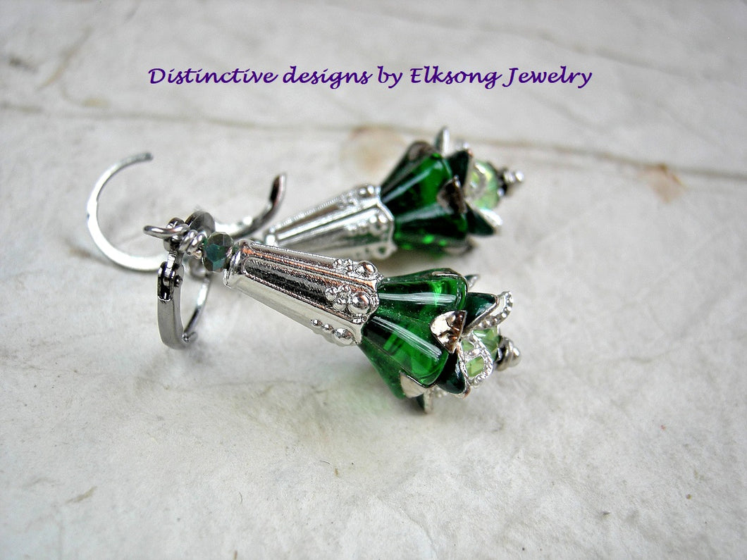 Flower drop earrings in Elven green & silver. Emerald green glass flowers, silver finish details & crystal.