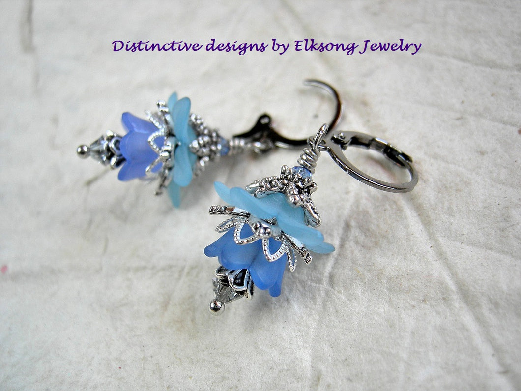 Sky blue flower earrings with resin flowers, silvery filigree & crystal. Vintage style faery couture earrings.