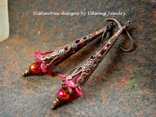 Load image into Gallery viewer, Crimson flower wand earrings with red resin  & glass flowers, glass beads & layered antiqued copper filigree cones, caps & beads.
