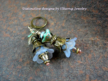 Load image into Gallery viewer, Double flower earrings in shades of blue with resin & glass flowers, faceted glass & crystal and antiqued brass.