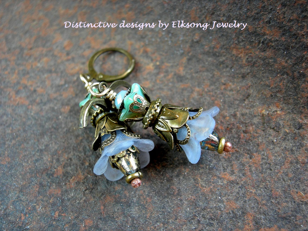 Double flower earrings in shades of blue with resin & glass flowers, faceted glass & crystal and antiqued brass.