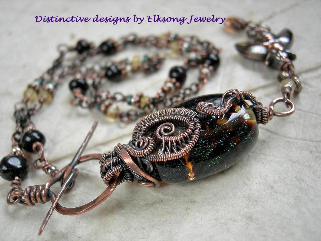 Dark Honey necklace, handmade lampwork glass focal, pale gold citrine & black amber. Copper wire wrap & front facing toggle clasp.
