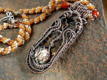 Load image into Gallery viewer, Copper tree statement necklace with wire wrapped tree & faceted carnelian focal, woven seed bead rope necklace. Shades of orange & copper.