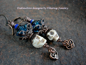 Ivory sugar skull earrings with teal glass flowers. Natural magnesite beads, antiqued copper details.