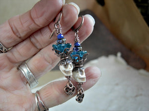 Mellow ivory color sugar skull earrings with teal glass flowers. Natural magnesite beads, antiqued copper details.