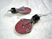 Load image into Gallery viewer, Earthy red pipestone wheel earrings with hand cut, natural catlinite, hand cut jet beads & copper wire wrapping. el earrings with hand c