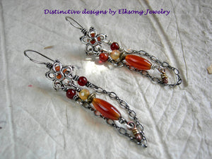 Slinky silver & carnelian chandelier earrings with orange gemstone beads,  Bali style stars & sterling chain drapes.