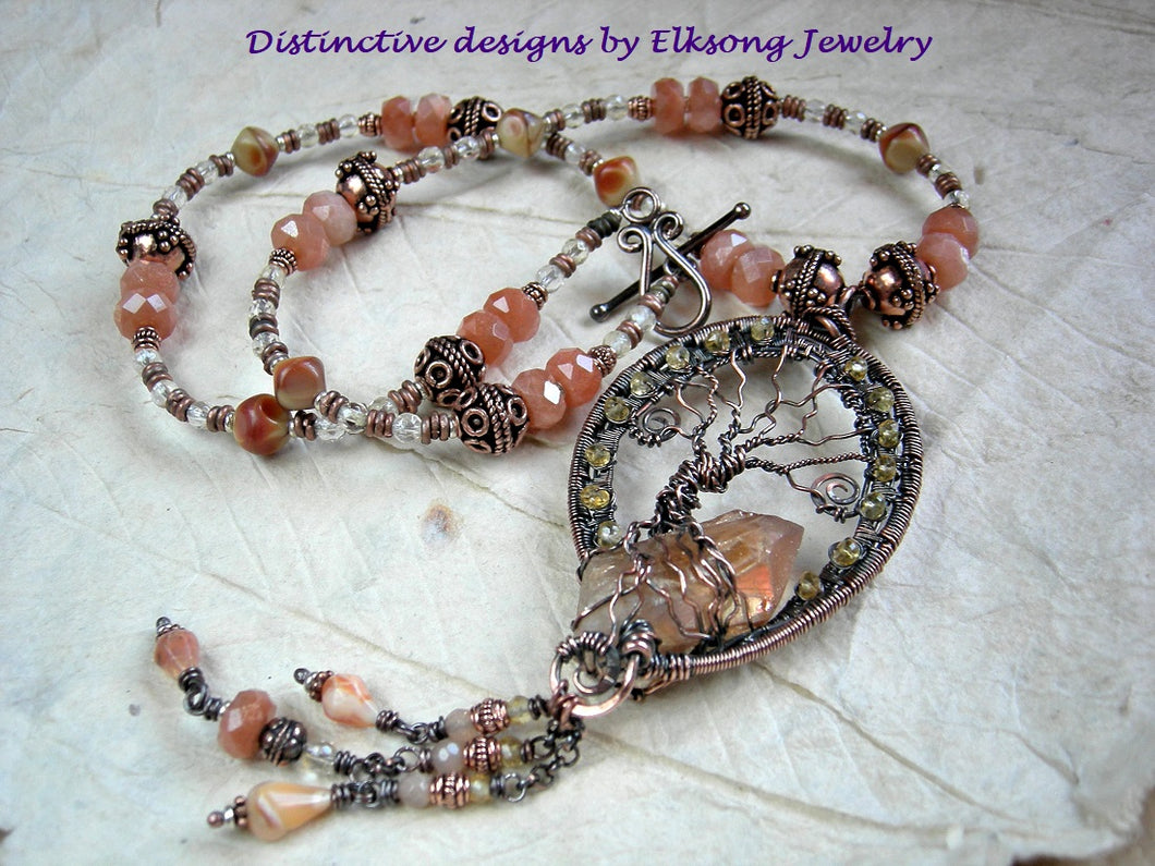 Elaborate copper wire wrap statement necklace with a tree & tangerine quartz focal, sunstone & citrine. Strung bead style necklace.