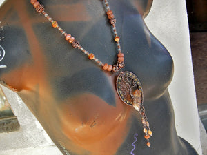 One of a kind copper wire wrap statement necklace with a tree & tangerine quartz focal, sunstone & citrine. Strung bead style necklace.