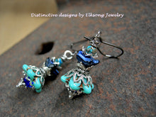 Load image into Gallery viewer, Blue & silver flower earrings in cool twilight colors. Turquoise & midnight blue glass flowers, silver filigree & caps, blue calsilica beads.