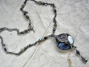 Boho luxe, sterling wire wrap necklace with luminous labradorite & faceted sapphire beads. Sterling toggle clasp.