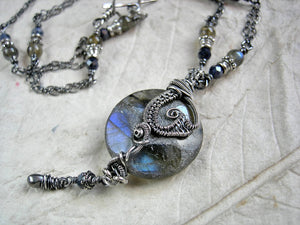Sterling wire wrap necklace with smoky blue gemstone & oxidized silver. Dark & luminous, boho luxe style.