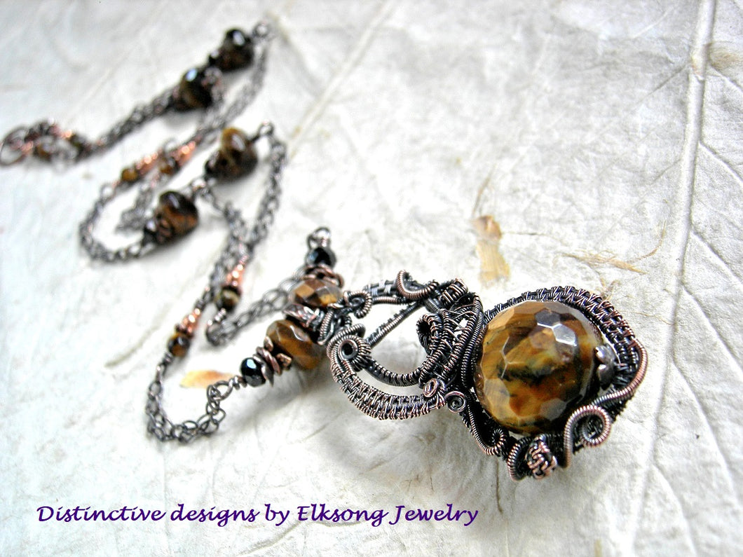 Tigereye & copper art necklace with oxidized wire wrap and faceted gemstone bead focal. Pendant length, chain style necklace.