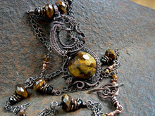 Load image into Gallery viewer, Elegant boho tigereye & copper art necklace with oxidized wire wrap and faceted gemstone bead focal. Pendant length, chain style necklace.