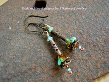 Load image into Gallery viewer, Tiny flower earrings in turquoise & topaz color. Glass flowers, antiqued brass filigree & Swarovski crystal.