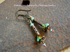 Tiny flower earrings in turquoise & topaz color. Glass flowers, antiqued brass filigree & Swarovski crystal.
