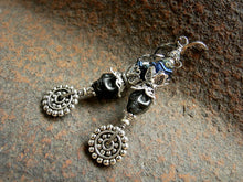 Load image into Gallery viewer, Dia de los Muertos style sugar skull earrings with black magnesite skulls, deep blue flowers & lots of silver details.